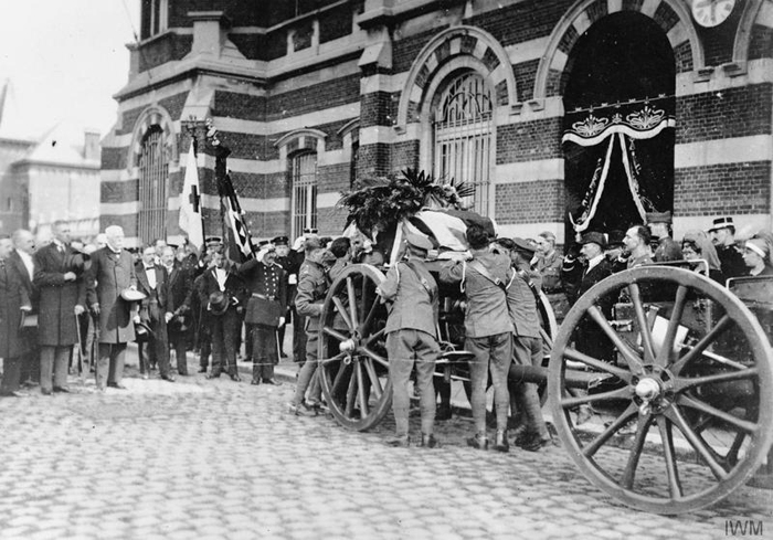 The body of Edith Cavell being taken from the mortuary for transport back to England, 13 May 1919. - © IWM Q 70081
