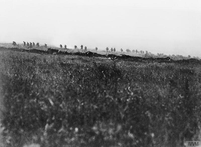 A support company of an assault battalion, of the Tyneside Irish Brigade, going forward shortly after zero hour on 1 July 1916 during the attack on La Boisselle. - Image courtesy of Imperial War Museum: Q 53